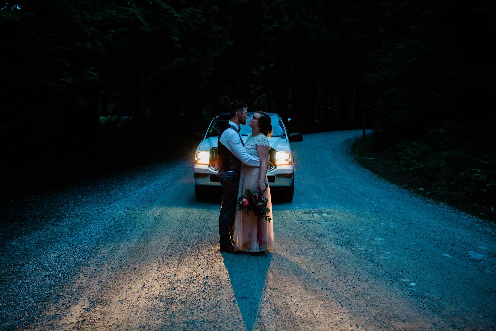 bride & groom with a limousine