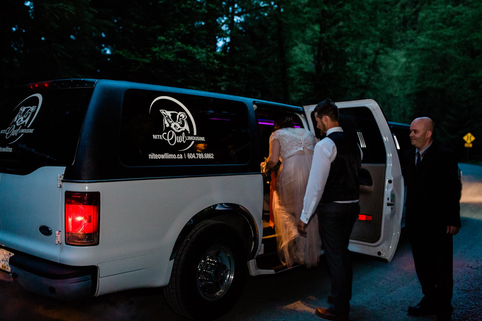 bride & groom in a limousine