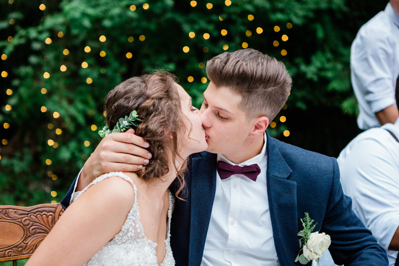 a kiss shared between the bride & groom