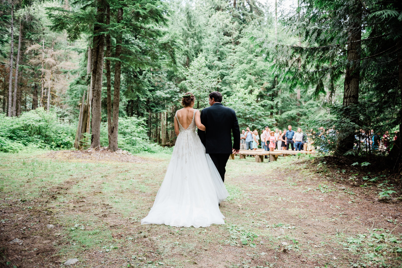 father walks daughter down the aisle at forest wedding