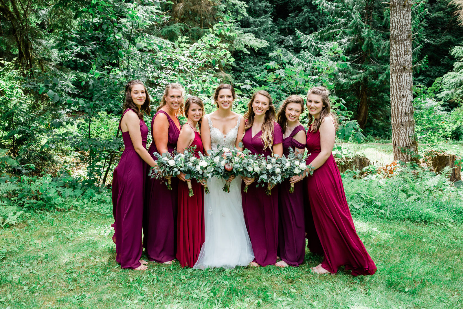 bride & her bridal party in the forest