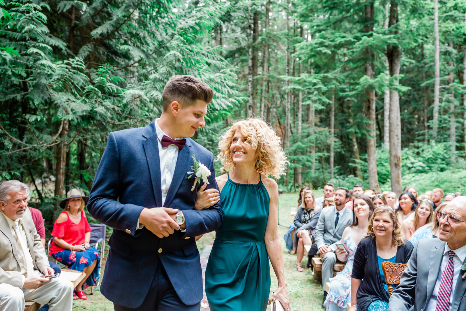 son walks with mom down the aisle
