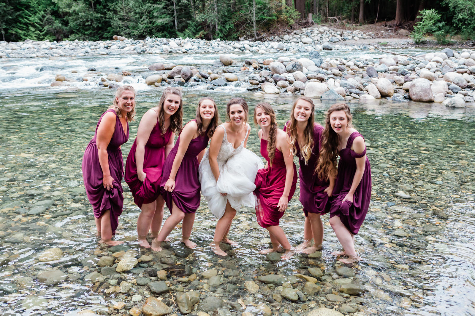 Bride & bridesmaid portraits by the river