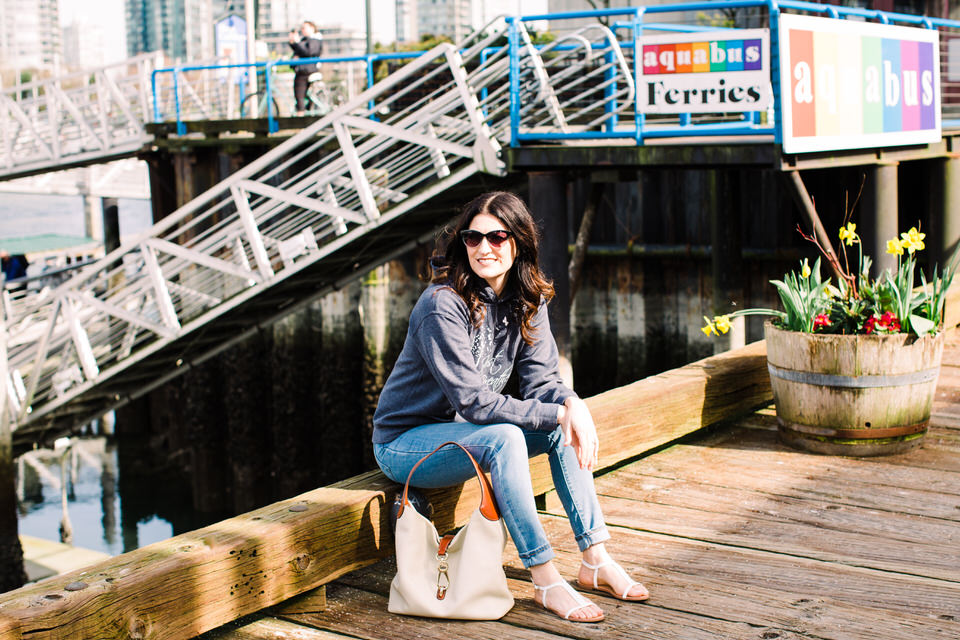 Woman sitting on dock waiting for ferry