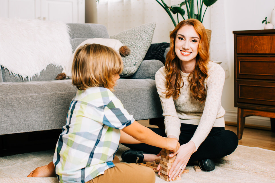Therapist sitting on the floor working with a child